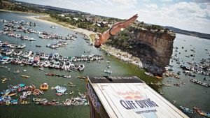 David Colturi of the USA dives from the 28 metre platform at Hells Gate during the second stop of the Red Bull Cliff Diving World Series at Possum Kingdom Lake, Texas, USA on June 7th 2014.